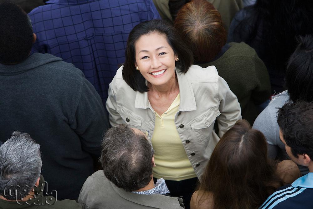 Woman standing among crowd