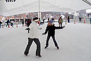 Maggie Hydler (left) and Kayla Shackelford, 11, both of Huber Heights during a session with mascot Parker the Penguin on the ice at the RiverScape MetroPark in downtown Dayton, Sunday, January 22, 2012.
