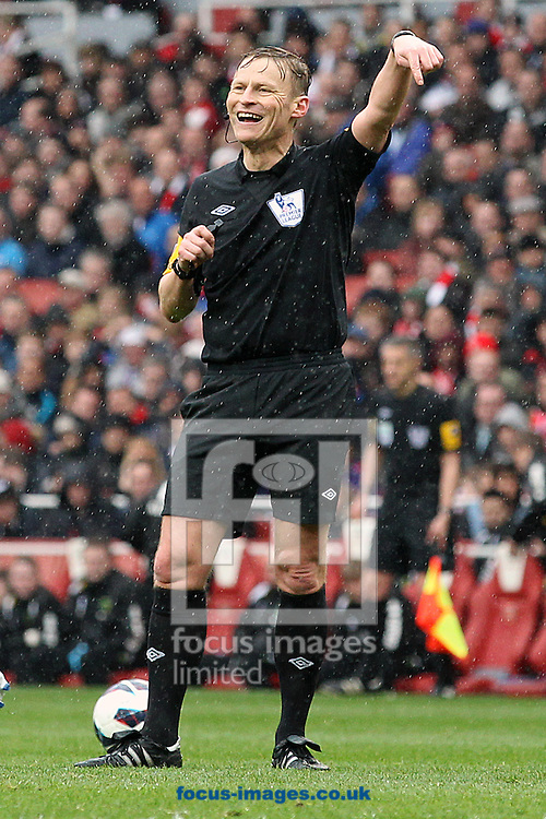 Picture by Paul Chesterton/Focus Images Ltd +44 7904 640267.13/04/2013.Referee Mike Jones during the Barclays Premier League match at the Emirates Stadium, London.
