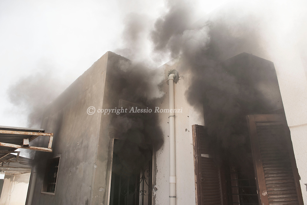 Libya: burning house in 700 neighbourhood in Sirte during the battle between ISIS and forces affiliated with Libya's Government of National Accord's (GNA). Alessio Romenzi