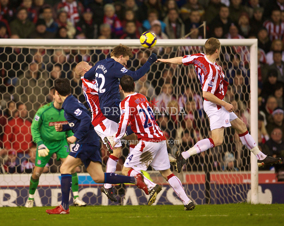 STOKE-ON-TRENT, ENGLAND - Saturday, February 27, 2010: Arsenal's Nicklas Bendtner scores the equalising goal against Stoke City during the FA Premier League match at the Britannia Stadium. (Photo by David Rawcliffe/Propaganda)