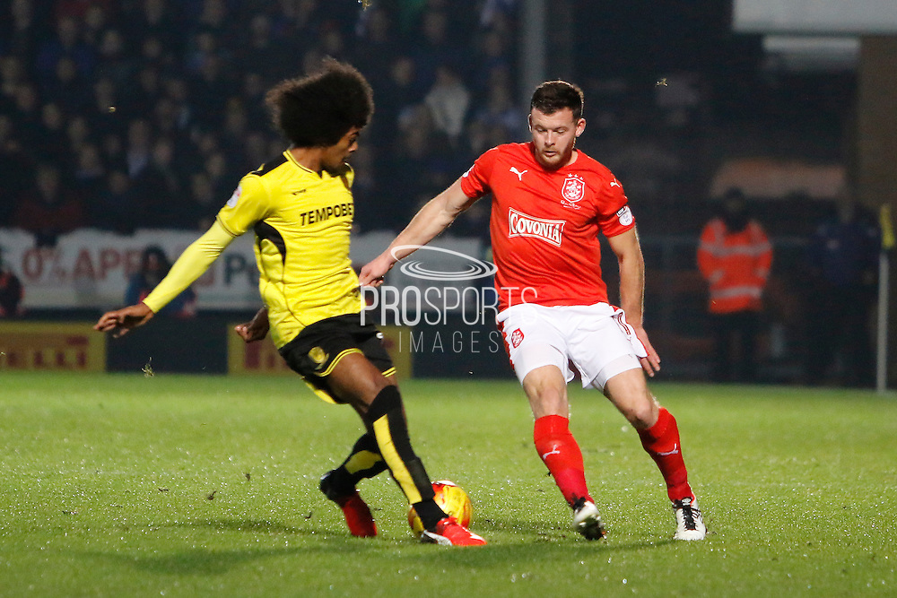Burton's Hamza Choudhury (19) and Huddersfield's Harry Bunn (11) during the EFL Sky Bet Championship match between Burton Albion and Huddersfield Town at the Pirelli Stadium, Burton upon Trent, England on 13 December 2016. Photo by Richard Holmes.
