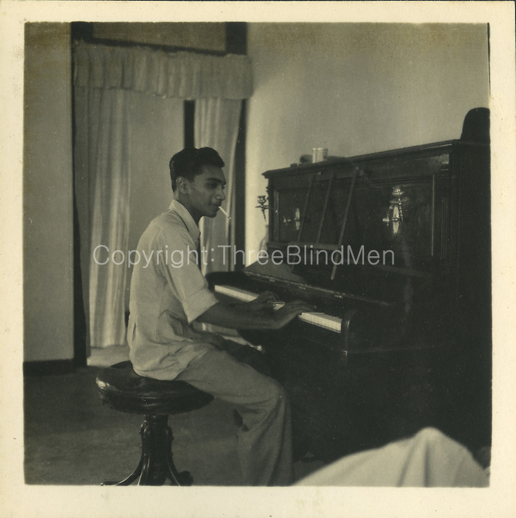 The piano player is Percy Weeraratne taken at my Uncles house 27 Elibank Rd which still exists more or less original. He was a commercial pilot but did not I think work for an airline but was at one time flying charters of fish&mdash;Batti to Colombo.<br /> from the Tony Peries Collection.