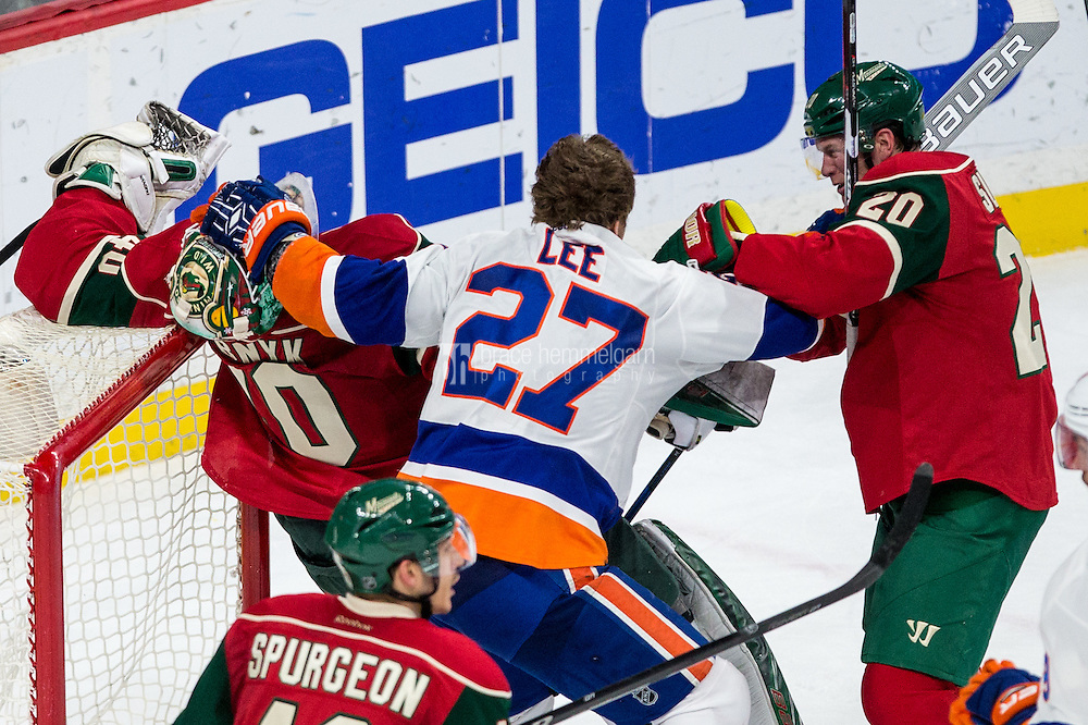Dec 29, 2016; Saint Paul, MN, USA; New York Islanders forward Anders Lee (27) grabs Minnesota Wild goalie Devan Dubnyk (40) in front of defenseman Ryan Suter (20) during the third period at Xcel Energy Center. The Wild defeated the Islanders 6-4. Mandatory Credit: Brace Hemmelgarn-USA TODAY Sports
