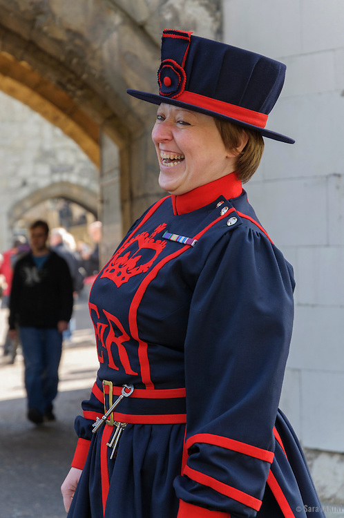 Moira Cameron, the Tower of London's first female Beefeater at entrance of London Tower, London, England, UK, Europe