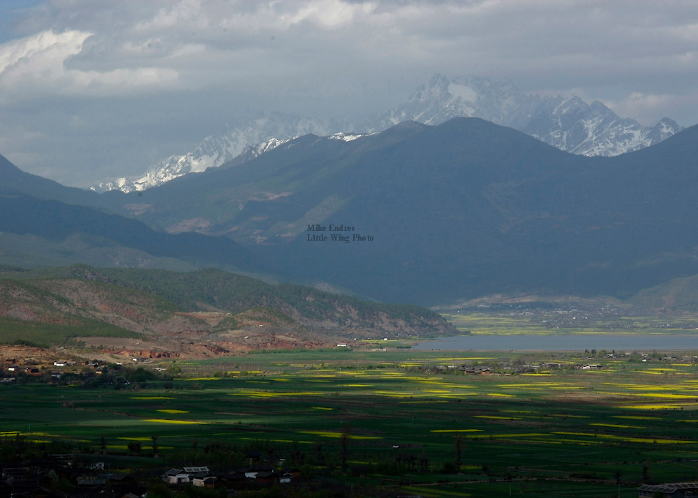 China is a big country and her landscapes are equally grand and impressive. Having 5000 meter high peaks rising out of a broad valley in the foreground, filled with the season's crops and humming with the business of a rural community, is an unforgettable opportunity for any photographer.