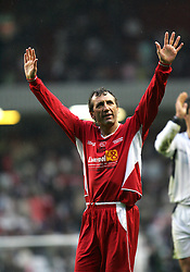 LIVERPOOL, ENGLAND - SUNDAY MARCH 27th 2005: Liverpool Legends' Alan Kennedy applauds the fans after beating the Celebrity XI during the Tsunami Soccer Aid match at Anfield. (Pic by David Rawcliffe/Propaganda)