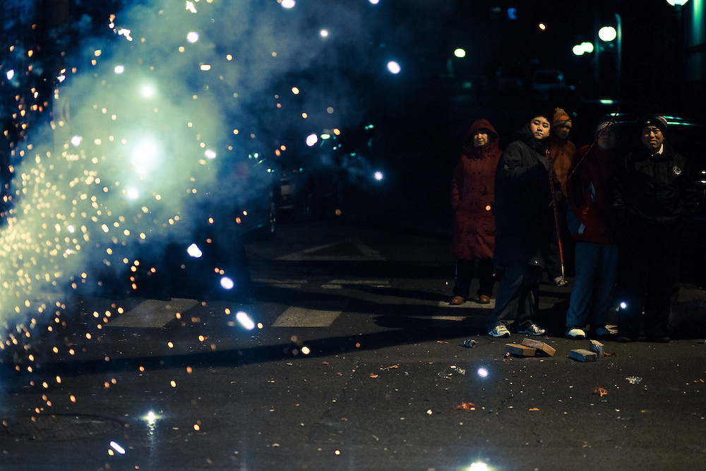 Beijingers are looking at fireworks they have lighted in streets of the chinese capital, near the Forbidden city, during the celebration of the New Year 2011 ( Spring festival, year of the rabbit)rabbit.