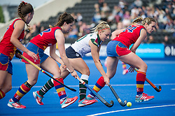 Surbiton's Hannah Martin drives into the circle through  three Birmingham defenders. University of Birmingham v Surbiton - Semi-Final - Investec Women's Hockey League Finals, Lee Valley Hockey & Tennis Centre, London, UK on 22 April 2017. Photo: Simon Parker