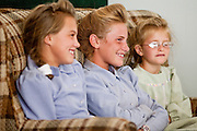 "Aug 10, 2008 -- COLORADO CITY: Girls in the Jessop family attend a prayer service in their home in Colorado City, AZ. The Jessops are polygamists and members of the FLDS. Colorado City and neighboring town of Hildale, UT, are home to the Fundamentalist Church of Jesus Christ of Latter Day Saints (FLDS) which split from the mainstream Church of Jesus Christ of Latter Day Saints (Mormons) after the Mormons banned plural marriage (polygamy) in 1890 so that Utah could gain statehood into the United States. The FLDS Prophet (leader), Warren Jeffs, has been convicted in Utah of ""rape as an accomplice"" for arranging the marriage of teenage girl to her cousin and is currently on trial for similar, those less serious, charges in Arizona. After Texas child protection authorities raided the Yearning for Zion Ranch, (the FLDS compound in Eldorado, TX) many members of the FLDS community in Colorado City/Hildale fear either Arizona or Utah authorities could raid their homes in the same way. Older members of the community still remember the Short Creek Raid of 1953 when Arizona authorities using National Guard troops, raided the community, arresting the men and placing women and children in ""protective"" custody. After two years in foster care, the women and children returned to their homes. After the raid, the FLDS Church eliminated any connection to the ""Short Creek raid"" by renaming their town Colorado City in Arizona and Hildale in Utah.     Photo by Jack Kurtz / ZUMA Press"
