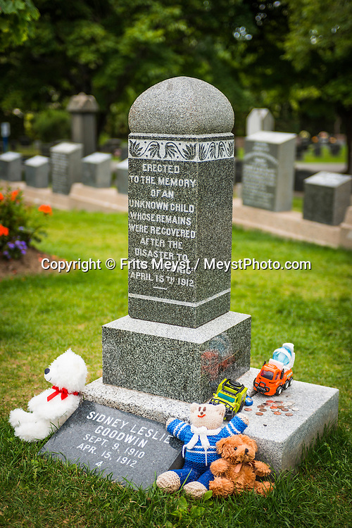 """Halifax, Nova Scotia, Canada, August 2014. Vicitms of the titanic disaster were burried at the cemetry of Halifax. Walk the ocean's edge along the historic Halifax waterfront. Start at Pier 21 – the gateway into Canada for one million immigrants – and then explore eclectic shops, some of the city's best restaurants, and ships including the last of the WWII convoy escort corvettes.<br /> <br /> Discover the oldest continuously operating farmers' market in North America, and exhibits at the Maritime Museum of the Atlantic including displays on the city's link to the Titanic disaster. End at the timber-frame & stone warehouses of Historic Properties – originally built to safeguard booty captured by legalized pirates called privateers. Nova Scotia was one of the original four provinces that became part of Canada in 1867.  """"Nova Scotia"""" is Latin for """"New Scotland"""", and Scottish settlers brought culture and traditions that continue to this day. Photo by Frits Meyst / MeystPhoto.com"""