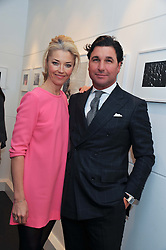 TAMARA BECKWITH and GIORGIO VERONI at a private view of photographs by Anthony Souza held at The Little Black Gallery, 13A Park Walk, London SW10 on 13th December 2011.