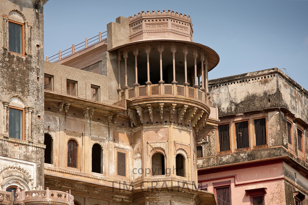 Typical Indian architecture at Rana Mahal Ghat on banks of The Ganges River in holy city of Varanasi, Northern India