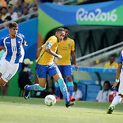 Football - Olympics: Day 12   Neymar #10 of Brazil is challenged by Kevin Lopez #11 of Honduras and Allans Vargas #5 of Honduras in action during the Brazil Vs Honduras Men's Semifinal match at Maracana Stadium on August 17, 2016 in Rio de Janeiro, Brazil. (Photo by Tim Clayton/Corbis via Getty Images)