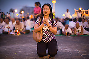 "29 JANUARY 2013 - PHNOM PENH, CAMBODIA:   A woman prays for late Cambodian King Norodom Sihanouk on the plaza in front of the Royal Palace in Phnom Penh. Sihanouk (31 October 1922 - 15 October 2012) was the King of Cambodia from 1941 to 1955 and again from 1993 to 2004. He was the effective ruler of Cambodia from 1953 to 1970. After his second abdication in 2004, he was given the honorific of ""The King-Father of Cambodia."" Sihanouk held so many positions since 1941 that the Guinness Book of World Records identifies him as the politician who has served the world's greatest variety of political offices. These included two terms as king, two as sovereign prince, one as president, two as prime minister, as well as numerous positions as leader of various governments-in-exile. He served as puppet head of state for the Khmer Rouge government in 1975-1976. Most of these positions were only honorific, including the last position as constitutional king of Cambodia. Sihanouk's actual period of effective rule over Cambodia was from 9 November 1953, when Cambodia gained its independence from France, until 18 March 1970, when General Lon Nol and the National Assembly deposed him. Upon his final abdication, the Cambodian throne council appointed Norodom Sihamoni, one of Sihanouk's sons, as the new king. Sihanouk died in Beijing, China, where he was receiving medical care, on Oct. 15, 2012. His cremation is scheduled to take place on Feb. 4, 2013. Over a million people are expected to attend the service.     PHOTO BY JACK KURTZ"