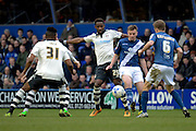Birmingham City midfielder Stephen Gleeson plays the ball away from Fulham striker Moussa Dembele during the Sky Bet Championship match between Birmingham City and Fulham at St Andrews, Birmingham, England on 19 March 2016. Photo by Alan Franklin.