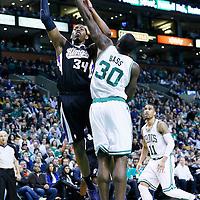 30 January 2013: Sacramento Kings power forward Jason Thompson (34) goes for the skyhook against Boston Celtics power forward Brandon Bass (30) during the Boston Celtics 99-81 victory over the Sacramento Kings at the TD Garden, Boston, Massachusetts, USA.