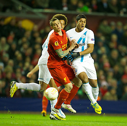 21.02.2013, Anfield, Liverpool, ENG, UEFA Europa League, FC Liverpool vs Zenit St. Petersburg, im Bild Liverpool's Daniel Agger in action against FC Zenit St Petersburg's Givanildo Vieira de Souza 'Hulk' during UEFA Europa League match between Liverpool FC and Zenit St. Petersburg at Anfield, Liverpool, Great Britain on 2013/02/21. EXPA Pictures © 2013, PhotoCredit: EXPA/ Propagandaphoto/ David Rawcliffe..***** ATTENTION - OUT OF ENG, GBR, UK *****