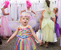 "Olivia Lawton dances to I'm a Little Teapot with ""Glitz"" and ""Glamour"" at Cackleberries Fairy Night Wednesday evening.  (Karen Bobotas/for the Laconia Daily Sun)"