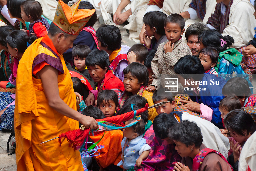Lama bless pilgrims at Blessing Festival, Punakha Dzong, Punakha, Bhutan