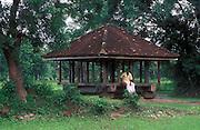 Sri Lanka. Man seated at Ambalama or Pilgrims rest in the Kurunegala District.