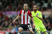 Brentford forward Lasse Vibe, Brighton defender, full back, Inigo Calderon (14) during the Sky Bet Championship match between Brentford and Brighton and Hove Albion at Griffin Park, London, England on 26 December 2015.