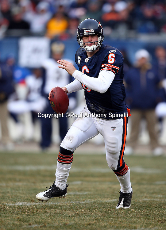 Chicago Bears quarterback Jay Cutler (6) rolls out as he looks to pass during the NFL football game against the St. Louis Rams on December 6, 2009 in Chicago, Illinois. The Bears won the game 17-9. ©Paul Anthony Spinelli