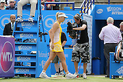 Caroline Wozniacki of Denmark leaving the court after withdrawing from injury during the Semi Final match between Caroline Wozniacki and Belinda Bencic at the Aegon International, Devonshire Park, Eastbourne, United Kingdom on 26 June 2015. Photo by Phil Duncan.