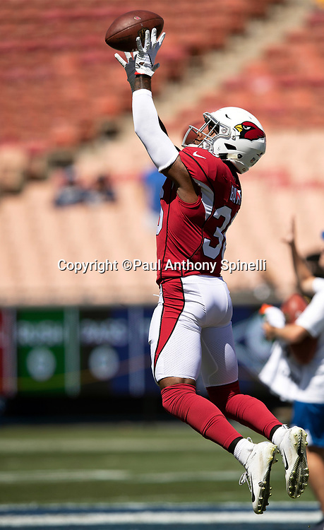 Arizona Cardinals defensive back Budda Baker (36) leaps and catches a pass during pregame warmups before the 2018 NFL regular season week 2 football game against the Los Angeles Rams on Sunday, Sept. 16, 2018 in Los Angeles. The Rams won the game in a 34-0 shutout. (©Paul Anthony Spinelli)