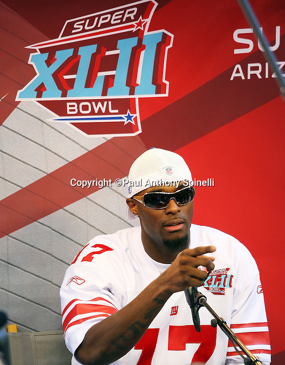 GLENDALE, AZ - JANUARY 29: Wide receiver Plaxico Burress #17 of the New York Giants points to a questioner as he speaks to the media at the Giants Super Bowl XLII Media Day at University of Phoenix Stadium on January 29, 2008 in Glendale, Arizona.©Paul Anthony Spinelli *** Local Caption *** Plaxico Burress