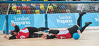 Amy KNEEBONE (CAN) backed up by Nancy MORIN (CAN) during Canada v USA, The London Prepares Goalball Paralympic Test Event - Poland  v China, Handball Arena, Olympic Park,  London, England December 3, 2011. Canada went on to win 5 - 1  Handball is played by blind or partially sighted athletes wearing