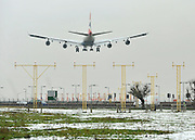 © Licensed to London News Pictures. 06/02/2012, Heathrow, UK. Planes landing across an icy feild. Snow and heavy fog continue to disrupt flights at Heathrow Airport today 6th February 2012. Heavy snow fell over many parts of the South East of the UK over Saturday night.  Photo credit : Stephen Simpson/LNP