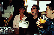 People drinking alcho-pops, beer, mixers and wine in pub, Newcastle, U.K, 2000's.