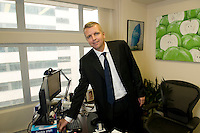 Patrick O'Donnell, owner and founder of Links Moving photographed in his company's offices in Hong Kong.
