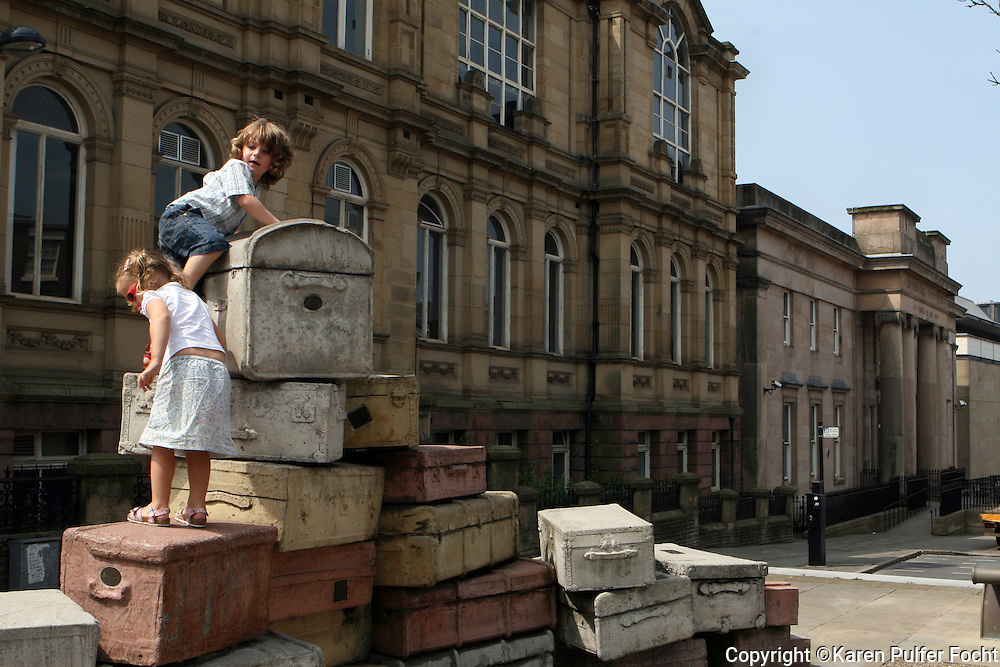 Children play outside the The Liverpool Institute of Performing Arts (LIPA) in Liverpool, England. Beatle, Sir Paul McCartney, hopes to use the arts to inspire young children.