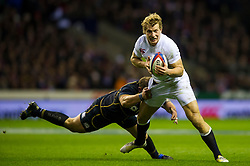 England Inside Centre (#12) Billy Twelvetrees (Gloucester) is tackled by Scotland Prop (#1) Ryan Grant (Glasgow Warriors) during the second half of the match - Photo mandatory by-line: Rogan Thomson/JMP - Tel: Mobile: 07966 386802 02/02/2013 - SPORT - RUGBY UNION - Twickenham Stadium - London. England v Scotland - 2013 RBS Six Nations Championship. The winner of this fixture is awarded the Calcutta Cup.