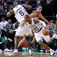 06 March 2012: Boston Celtics shooting guard Ray Allen (20) drives past Houston Rockets shooting guard Kevin Martin (12) on a screen set by Boston Celtics power forward Kevin Garnett (5) during the Boston Celtics 97-92 (OT) victory over the Houston Rockets at the TD Garden, Boston, Massachusetts, USA.