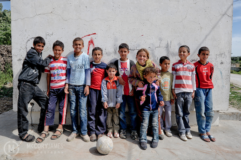 Kids pose with their soccer ball in the village of Alia, Tunisia