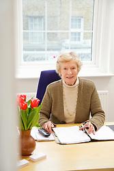 Senior Businesswoman Sitting at Desk