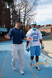 14 February 2009: North Carolina Tar Heels assistant coach Greg Paradine with defenseman Milton Lyles (29) during the halftime of a 20-7 win over the Denver Pioneers on Fetzer Field in Chapel Hill, NC.