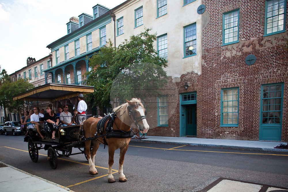 Horse carriage stops at the historic Dock Street Theatre in Charleston, SC.