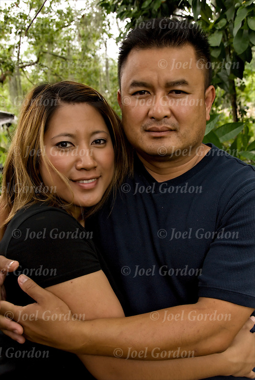 Laotian American Couple.  Laotian community settled in Putnam County FL in the late 1970's after the Vietnam War ended. The first refugees worked as farm labors, sending their children to school and then on to college. The second generation, found little or no employment in Putnam County a poor county and left for the cities for jobs.  The family is central to the Lao culture, the very close Laotian community will come together in support of their fellow Laotians.  The U.S. Census 2000 there are 3,522 in Florida..
