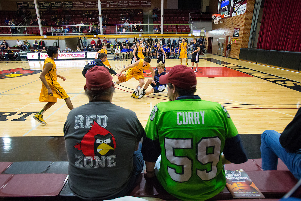 GABE GREEN/Press<br /> <br /> Spectators watch Coeur d&rsquo;Alene High School players battle it out against Kelowna High School Friday at the Coeur d&rsquo;Alene Inn-Vitational.