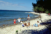 Family on the shore of Lake Michigan ages 40 and 4 through 12.  Door County  Wisconsin USA