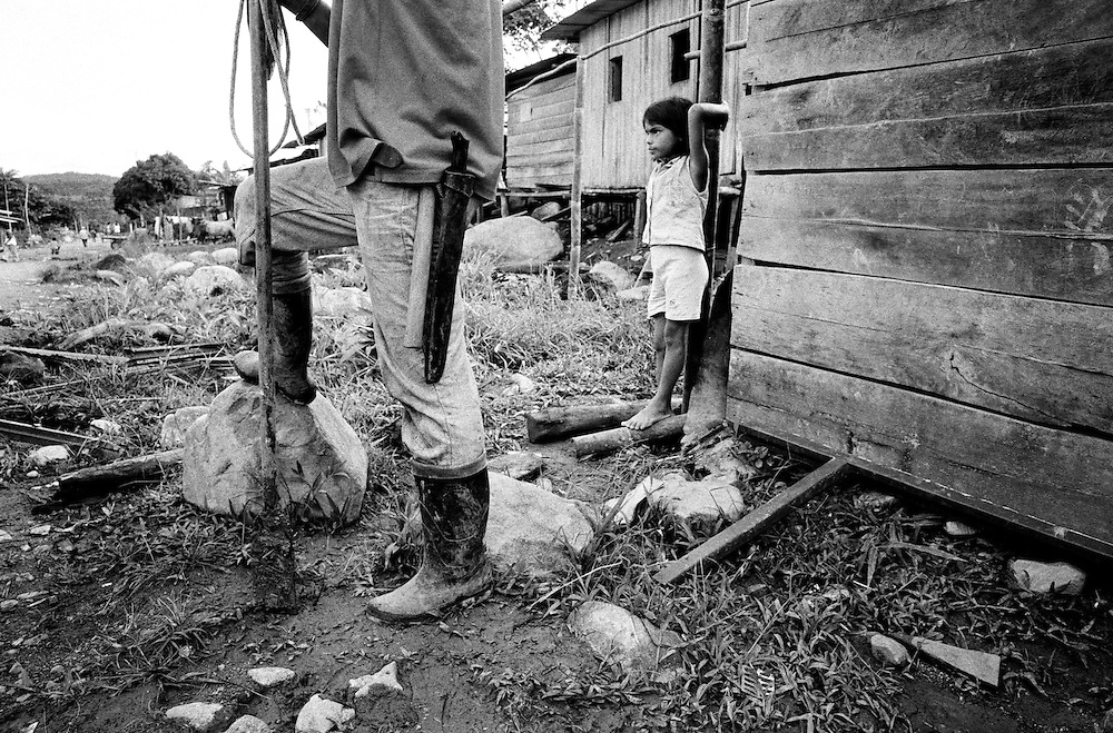 A family displaced by recent violence begin to construct a new home.<br />