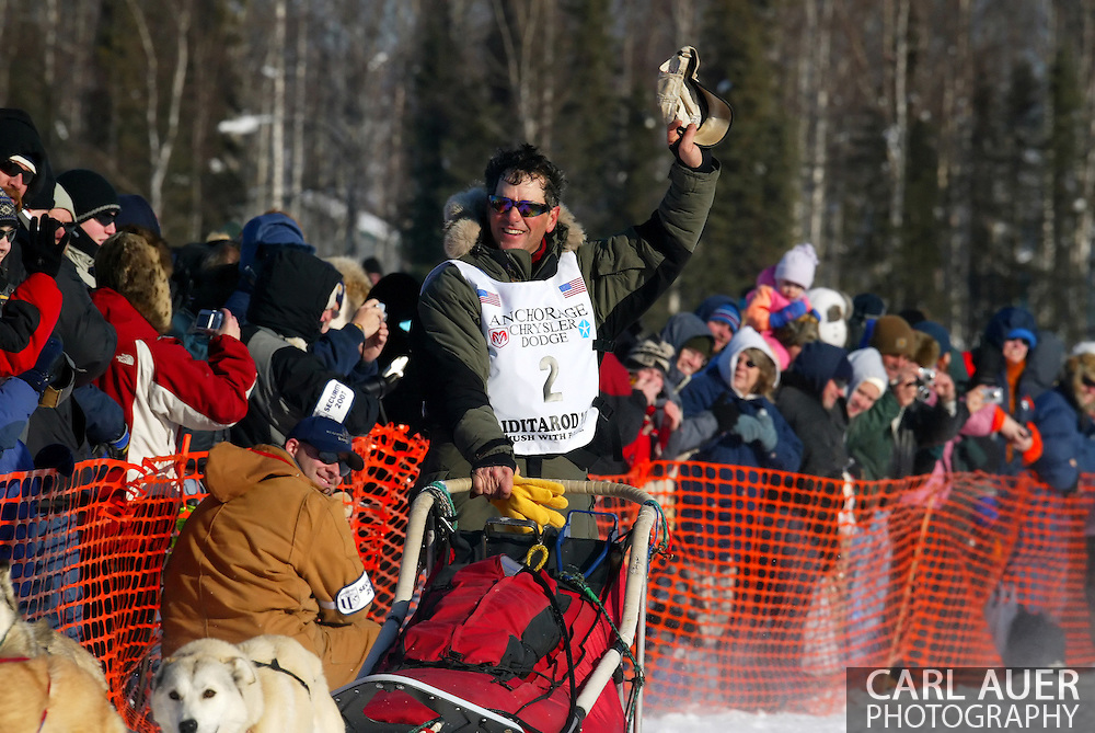3/4/2007:  Willow, Alaska -  Veteran Perry Solmonson of Plain, WA waves to the crowds gathered on Willow Lake as he heads out for Nome, 1049 miles away at the beginning of the 35th Iditarod Sled Dog Race