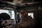 Iraqi Special Fores ride in an armoured vehicle through the liberated streets of Mosul's Old City.