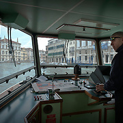 Vaporetto driver in the Grand Canal