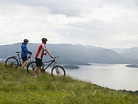 Couple on bicycles near lake