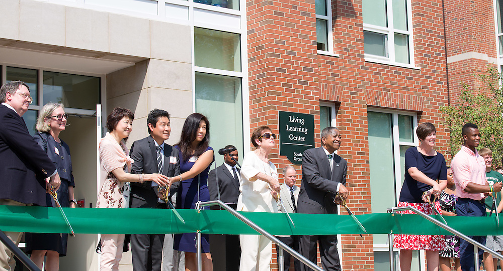President McDavis, Jennie Hall-Jones and the families and honories cut the ribbion marking the grand opening of the new five residential halls on south green.